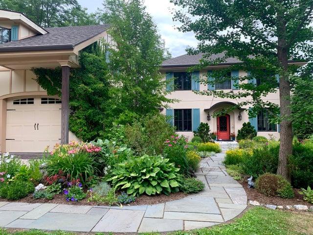 Charming entry through beautiful perennial gardens.