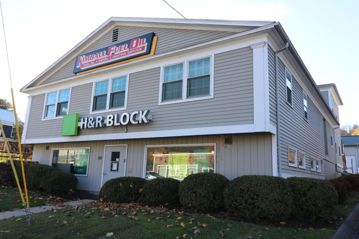 Front of the building facing Main St. H&R Block on ground level & Dr. offices windows on 2nd floor.