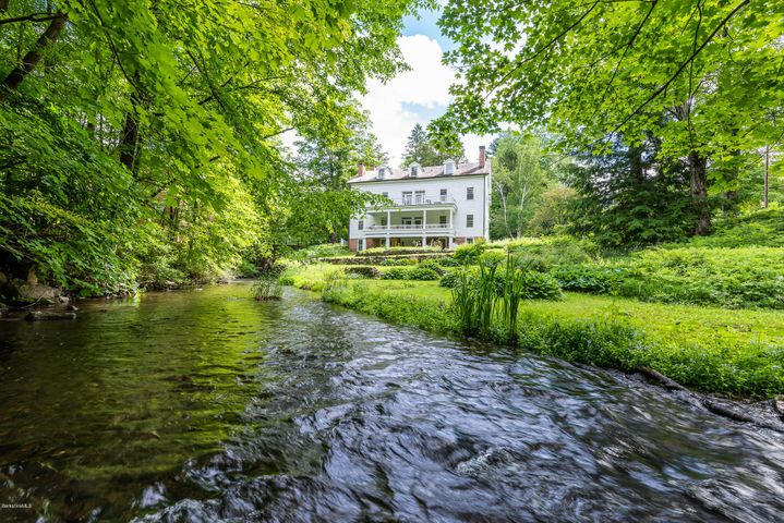 Extensive, beautifully designed and maintained gardens lead to resting an gathering spots along Larrywaug Brook.