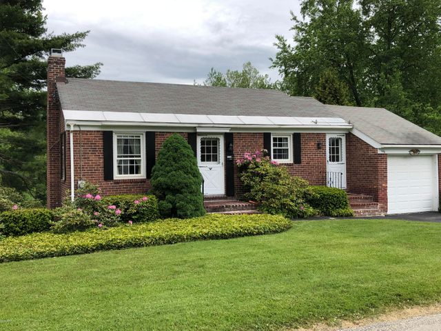 Charming brick Ranch located in the desirable Colonial Village- just minutes away from downtown!