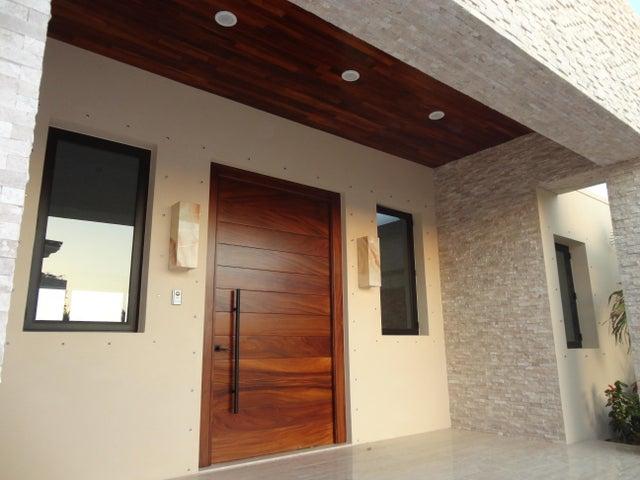 10' Parota door with travertine floor and Parota ceiling