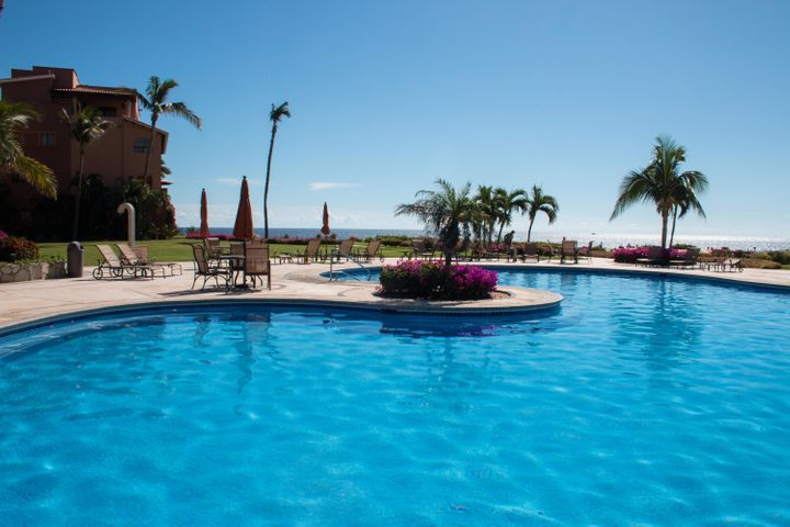 Lush gardens and sparkling pools at Casa del mar