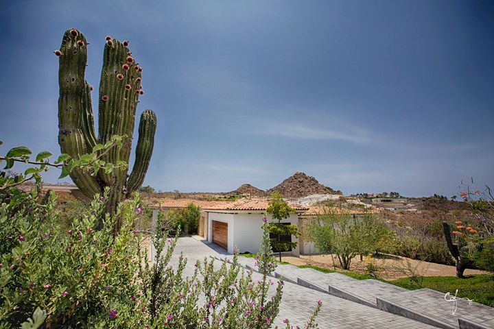 Tucked away private home on large Fundadores lot with additional room to build.