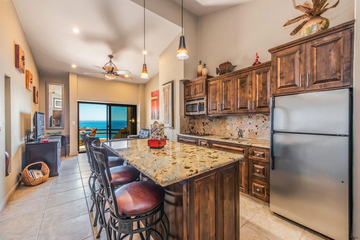 Kitchen features Granite Counter-Top Island and Breakfast Bar.