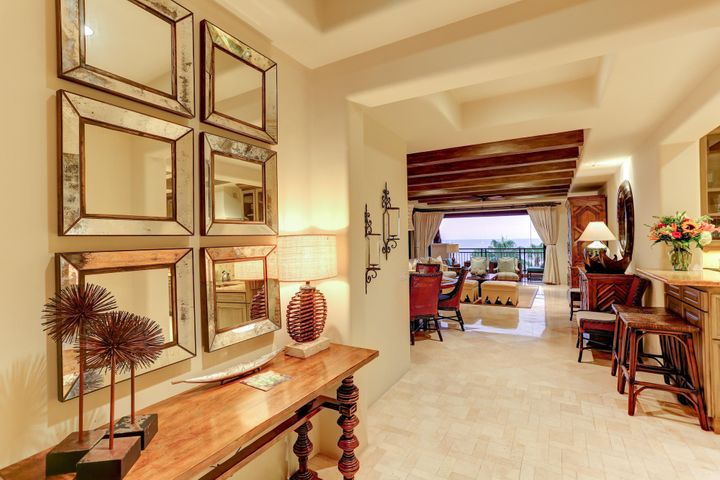 This 3 bedroom plus den is simply georgeos, fully furnished and ready to move in and rent it. Great rental income. This condo offers beautifully appointed indoor and outdoor spaces, a wraparound terrace with dramatic balconies, and spectacular views of Land's End and Cabo San Lucas Bay.This premier location on Medano Beach is a short walk to Puerto Paraiso Mall, Cabo's world-class marina, downtown, and all of Cabo's nightlife. The resort amenities include a fabulous beach club, seaside lounge, gourmet dining, full service spa, fitness area, and concierge services. Enjoy the luxury, comfort, and convenience of owning in Hacienda.