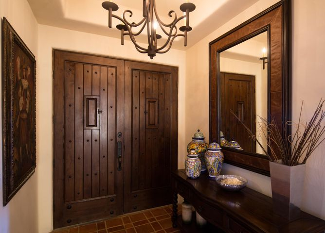 Enter into a Hacienda home through  double wood doors that lead into an open floor plan with living room, kitchen and dining area.   The comfortable living area is open to the kitchen and plenty of room to gather with friends and family around a granite topped island counter.  Touches of colorful tile in the country style kitchen offset nicely with authentic Mexican Saltillo flooring.  A small office is conveniently located at the entrance to the residence along with a guest bathroom.  The Master bedroom suite has a king size bed that enjoys a great view towards Lands End.  This amazing view from third floor residence has enclosed front terrace perfect for family with small children. Two spacious guest bedrooms with private bathrooms complement this family friendly residence. Turn key.