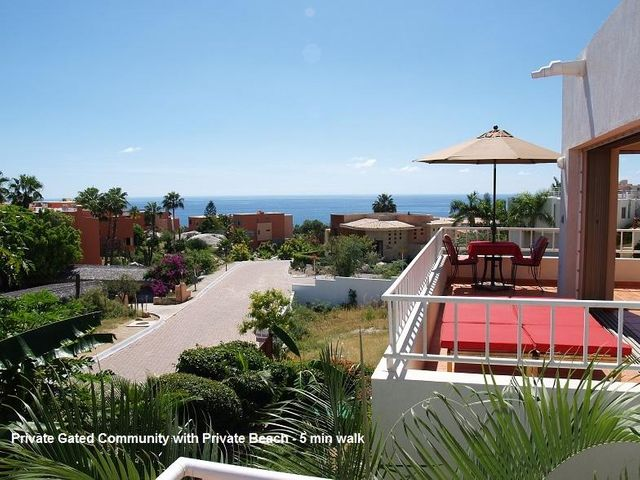 DUPLEX or one large home. Extensive views!! Income producing. 6 bedrooms & 6 1/2 baths.  3/3 1/2 up, 3/3 down. Wide open floor plan. Full custom kitchens.  Sea of Cortez views from both levels. Stairs to 3,000 sq ft rooftop deck plumbed for water, elec & propane perfect for a future fire pit/barbeque with Arch and 180 degree Sea of Cortez views. 2 water purification systems, large septic tank and 2 separate electric meters, large 2 car garage and a gated storage area on side of house for boat and lots of toys. 5 minute walk to swimming cove or to famous Monuments' surfing beach.