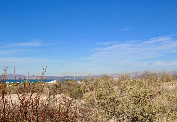 Large serviced view lot in Bahia Vista!Property in Bahia Vista has great views of the Bay, mountains and city lights.  Electricity, water, and sewer are at the lot line.  Each lot is 1422 m2, roughly 1/3 of an acreplenty of room to build your dream home.  Bahia Vista is located in the hills just north of El Centenario, a small town where you can buy just about everything.  Major shopping (Home Depot, Walmart, Sam's Club, Liverpool) is only 10 minutes drive away.