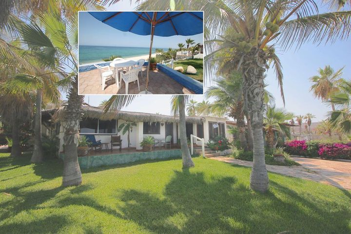 This beachfront home in Buena Vista is a rare find. The home sits on a bluff above a white sand beach with great views. The property is just under an acre with room to add more structures or separate rentals. There are patios with great views over green grass to the ocean side plus a private back patio area with a fountain. The home is beautifully landscaped and priced to sell! 4 bedrooms 3 baths, separate laundry room, carport, palapa shaded parking and a small garage.