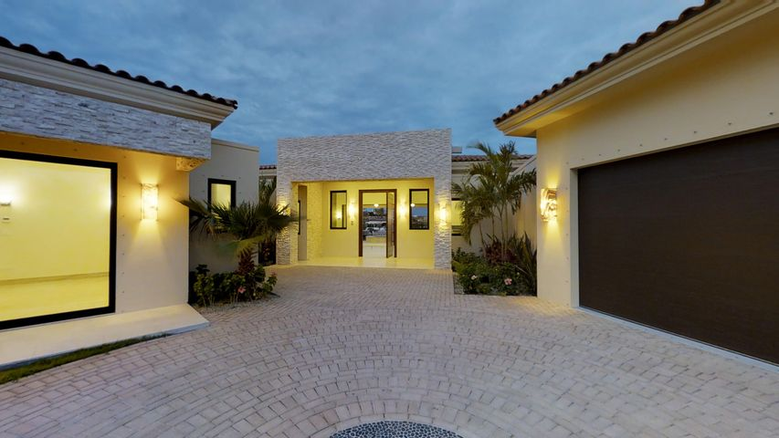 This newly constructed villa is Mexican Contemporary with an open floor plan and features that include: Parota wood cabinetry, doors, and ceiling treatments; large vein cut travertine flooring, gourmet kitchen with pass-through to outdoor bbq station; clean lines, indirect lighting, white stone accents both interior and exterior located on the 4th fairway in Fundadores with unobstructable ocean views from 2 master suites. Storm protection screens included.