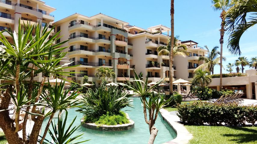 Great ground floor Villa, has direct access to front pool, restaurants, and the beach. Great rental income. Financing Available