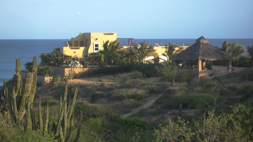 PRICE REDUCED OVER 500K! BRING ALL OFFERS! One-of-a-kind private beachfront compound in the Punta Perfecta area of the East Cape. Great vacation rental with plans ready to go to expand with three more casitas, quadrupling the potential income. 1.7 acres of land with 40 m (131ft) frontage. Beautiful ocean and mountain views. Main house 3700 sqft under roof 3 bdrms/3bath/2 half baths, all bedrooms in main house with AC. Guest casita 1025 sqft 1 bdrm/1 bath is a very popular vacation rental with across the board five star ratings. Separate caretakers casita 300 sqft 1 bdrm/1 bath. 15,000 gallon water tank storage. Solar-powered w/10K Kohler back-up generator (propane). Seller-Provided-Financing considered for qualified buyer able to put 50% down. BRING ALL OFFERS! *PRIVACY abounds on this property *Beach is rarely used by others, feels like it's all your own and goes for miles! *Over $35K/yr in vacation rentals! *Lots of room to build additional casitas.   *View to world class surf break at Punta Perfecta.