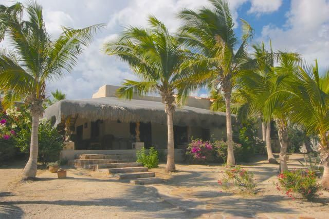 This 1500 square foot home has a large studio space that can be converted to a two car garage. There is a stairway to a large roof deck above the home, plus there is plenty of room to build a beachfront home on this property.