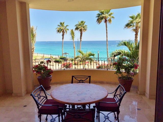 If you were any closer to the water, you would be in it!! This fabulous location is steps from the ocean and overlooking the pool...the view is spectacular. Great financing available with this unit! Bring your most discerning clients.