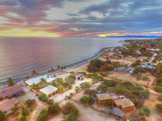 This home has just been marked down from $1,295,000, and the owners are ready to sell! 3 bedroom 2.5 bath home has an extra beachfront lot for privacy for a pool or you or a partner can build another beachfront home. The home is spacious and has an artistic feel. There is a Casita in a separate house on the adjacent lot.
