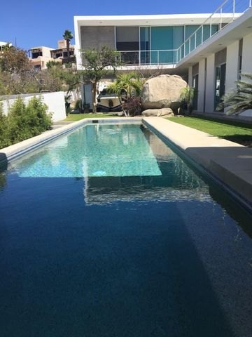 This contemporary, newly constructed home has clean lines, water views and stunning outdoor living areas.  All rooms open out to great landscaped yard &  pool area.  This 4 bedroom 4 bath home has fire and conversation pits, built in grill and lap pool.  There are 3 bedrooms inside the home and an exterior casita w/kitchen and bath.  House is fully furnished. Have or want toys????  Home has a carport that can be enclosed into a garage.  Parking to accommodate 6 cars. Located in Cabo Bello with a swimmable beach, next to Blue Net hospital and plenty of great restaurants - all within walking distance.  House has a flat roof for adding roof top deck.If you like shiny, new & spacious outdoor living, this house is for you!!!