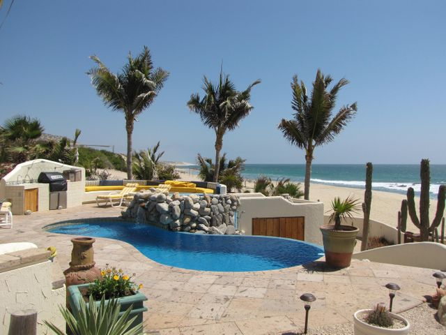 Beachfront, secluded and very private home in the East Cape, just North of San Jose del Cabo featuring lush mature gardens of local vegetation with outdoor lighting and swimming pool. Main house with 2 bedrooms and full baths (double sinks in master bath). Kitchen equipped with Viking stove and GE Stainless steel refrigerator. Double Maytag dishwasher, full hand-made porcelain sink. All services taken care of: private well with 8,000 gallon cistern and pressure pump. Solar power fueled by 116 panels with complete equipment. Double garage, with washer/dryer, custom built in cabinets and also a second one car garage with custom made cabinets. Detached guest house 1 bedroom, full bath, full kitchen with A/C. Dog condo with A/C! Great area for surfing.