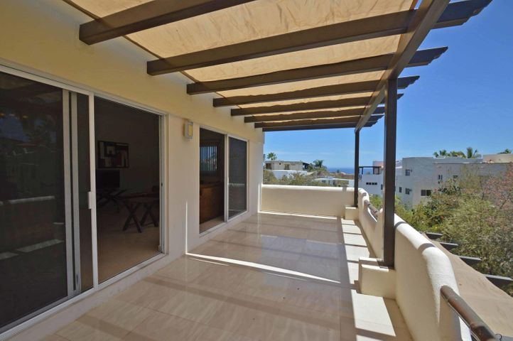 Great 2 level home located at the Gated Beachside Community of Cabo Bello in the Corridor, only 5 min from Cabo San Lucas and walking distance to a swimmable and private beach!A perfect retreat home!! Terrace on upper level with ocean view.Spacious Master bedroom with private terrace and sitting area. Second bedroom has private terrace.