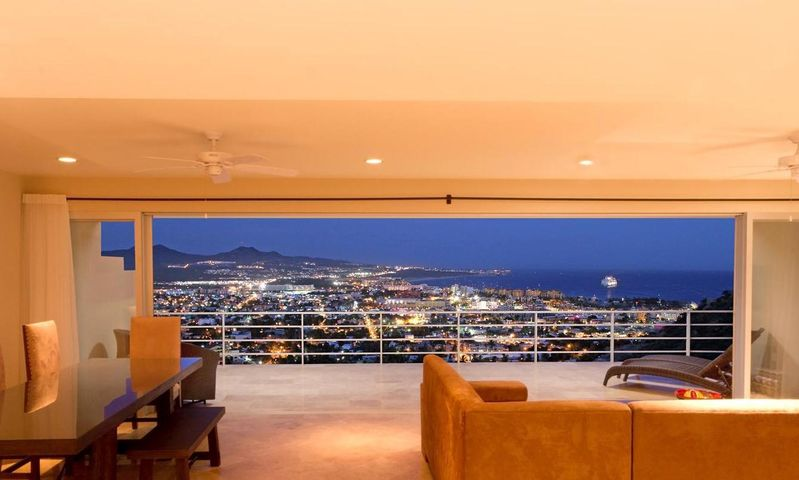 Night time view of luxury condo | The Ultimate Los Cabos Homebuyer Guide