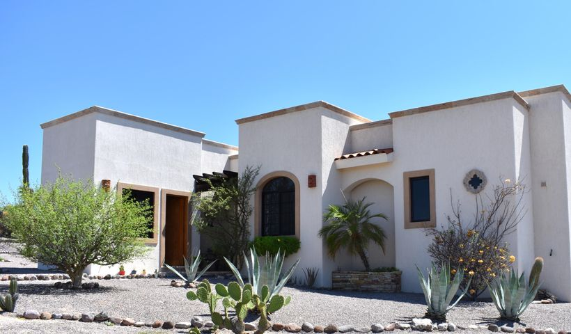 Smart buy: the lowest priced home in the best El Centenario neighborhood! This 3BR/2BA home located in the private gated community of Haciendas Palo Verde features an open-concept floorplan, stainless appliances, granite countertops, tile floors, hardwood finishes, and ocean views from both the outdoor terrace and rooftop patio. Situated on nearly 0.4 acres with plenty of room for a pool. The separate 3rd bedroom is ideal as an art studio or office. Community amenities include paved roads, a clubhouse with gym and lap pool, underground utilities and gated, 24-hour security. Just minutes to shopping at Walmart, Home Depot, Sam's Club and an easy drive to downtown La Paz.
