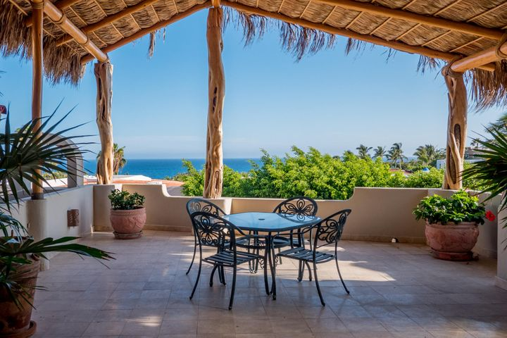 Welcome to Casa Tres Palmas. This charming partially renovated 3-bedroom home is located within walking distance to the beach on the Pacific side of the exclusive gated community of Pedregal.  Million-dollar ocean views from almost every room in this home make it an entertainer's dream.The master suite in this home is truly a private retreat where you can relax, enjoy early morning Cabo breezes and calming ocean views while sipping coffee on the private master suite deck or watch the epic ocean sunsets Cabo is famous for.Watch boats sail by while preparing meals from your newly renovated chef's kitchen complete with granite countertops, stainless steel appliances, new cabinetry and built in breakfast bar. Bask in ocean sunsets while hosting your friends in your spacious living room, adjacent ocean view outdoor patio and semi-formal dining room. Encircling the rear of the home is a spectacular private backyard oasis that must be seen to be appreciated. Ensconced under a canopy of foliage, the massive brand-new Pebble Tec pool with swim up bar, sunbed area, al fresco dining space, outdoor pizza oven and outdoor washroom offer you and your guests the most in comfort, privacy and relaxation.    This home also has great rental income potential with the third bedroom being a full suite lock off on the lower level. This home must be seen to be fully appreciated. The home has been renovated with new palapa, granite counter tops, new kitchen cabinets, bathtubs and fixtures, A/Cs, swimming pool and water pump.