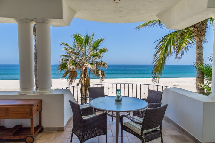 """AHHHH NOTHING HERE BUT BLUE WATER AND WHITE SANDY BEACH!Unobstructed views of the Sea of Cortez from Punta Gorda to the Palmilla Bay! This well-appointed beachfront condo is centrally located on the 2 nd floor, buffered from neighbors, very private. One owner for many years has not been used as a rental however would make a great vacation rental for extra income if needed. Over 1800 sq. ft. of open and spacious living, 2 bd. 2 full Ba. The large patios are perfect for dining, relaxing and enjoying the endless views. Recent complete remodeled to include: top graded hurricane glass doors, kitchen, baths, flooring and furnishings. 3 pools, Jacuzzi's, full gym, tennis courts, 24 hr. Security and beautiful gardens. ''Mykonos Bay Resort'' is just steps away to the famous ''Zippers'' surf break Super clean and appointed with high quality fixtures and furnishings. Owners rent a garage that """"may"""" be transferable? Entry construction beautification completed Nov. 2018, will be gorgeous with no added fees for new owners."""