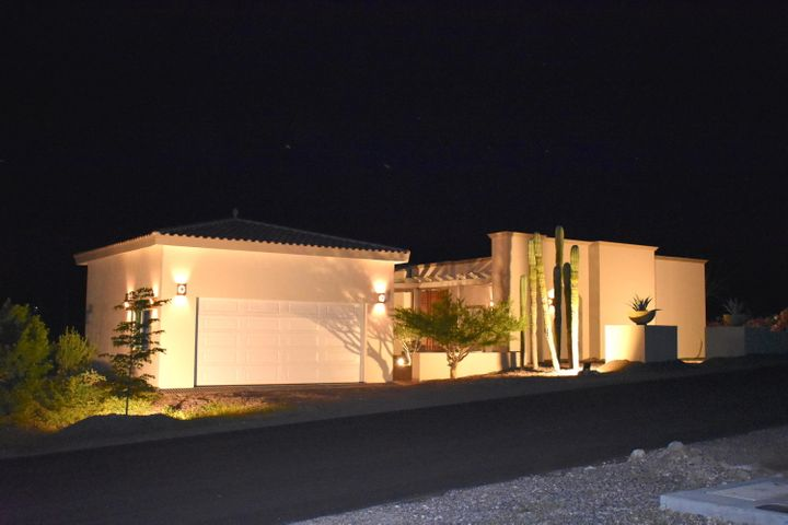 This beautiful custom home is situated in Haciendas Palo Verde, the only gated community in El Centenario. The modern designed home features 3 bedrooms and 3 bathrooms and more than 2,500 square feet of living space. The beautiful double wooden entry doors open to a spacious floor plan with high ceilings, 2 true master suites each with their own large closets and bathroom, and a 2-car enclosed garage with attached third bedroom/office and bathroom. The home was built to US standards using US certified electrical wiring and double-paned glass doors and windows for energy efficiency. The home is across the road from the public pool but the >1/3 acre lot has plenty of room to add a pool with views of the ocean from the terrace, and it is next to reserve space for additional privacy. Easy to add stairs to rooftop. Haciendas Palo Verde features 24/7 gated security, paved roads, underground utilities, and a casa club with lap pool, picnic area and gym.