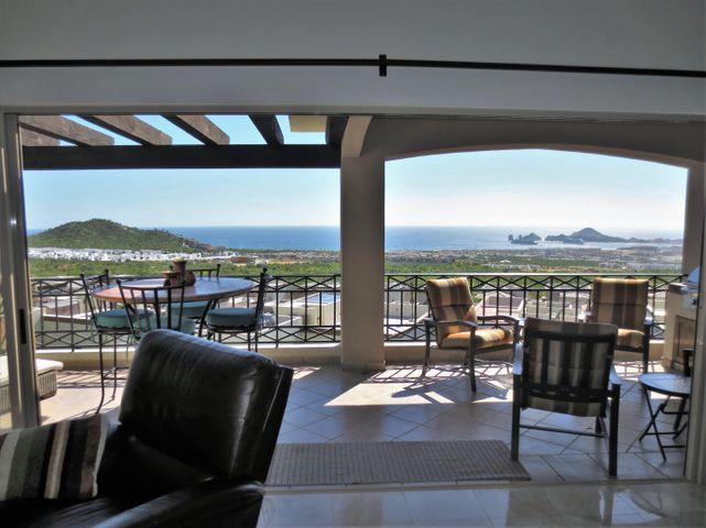 Seller financing available. Gorgeous furnished/turnkey Penthouse w/ many upgrades. Hosting commanding blue water, lands end, sunsets & Cabo city night lights views. Custom furniture, 3 stage water uv/filtration system for entire unit, built in outdoor stainless BBQ (hard piped), sink & too much to list. Lockable storage outside the front of the condo for beach toys, etc. 2 car covered parking can be enclosed. Fully completed amenities w/ an adult infinity edge pool w/ the same views as the unit, large family pool, many sitting/entertaining areas, full bar/deli w/ inside & outside sitting, 2 gym areas, space for special classes, game room & all w/ blue water views. Neighboring amenities in Ventanas Phase 3B to share/compliment amenities to 3A to include spa services & extra bonuses to enjoy