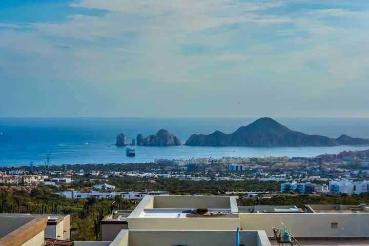 This Stylish, 1,450 sq ft 2 Bedroom, 2 Bath, Ocean View Condo boasts Spectacular Views of Land's End, Cabo San Lucas Bay, City Lights and Breathtaking Sunsets. Features a 277 sq ft South Facing Terrace with Built-In Outdoor Kitchen with BBQ. Top of Line Finishing includes Granite and Marble. Wonderfully, Fully Furnished and Equipped with all Appliances including Fridge, Stove, Microwave, W/D, plus Wine Cooler Fridge. Many Developer Options: Ceiling Fans in each BR, 2 in the Livingroom, 2 Outside on the Terrace; 2 Garage Stalls, 1 with 3M x 1M Custom Storage Cabinet, Hurricane Shutters, and Water Purification System. Community includes Family Pool, Adult Roof-Top Pool, Fitness Center, Spectacular View Lounges, Billiards, and Restaurant/Bar. Resort Living. Great Vacation Rental Potential.