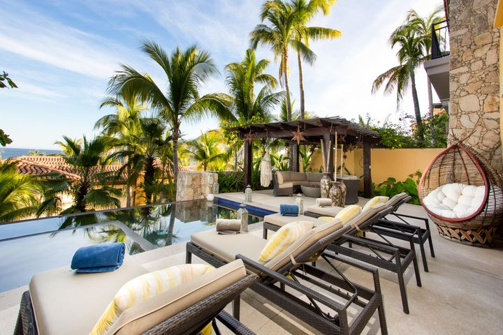 Situated inside Hacienda Beachclub & Residences is a stunning ground level 3 bedroom 3 1/2-bathroom Veranda with ocean views overlooking Medano beach.  This charming residence has an open and spacious floor plan with a large covered terrace and backyard that is great for entertaining. It comes furnished with a large master suite, private infinity edge pool, Jacuzzi, Gazebo, fire pit & outdoor cooking area.  This Veranda has 2,390 sq. ft. of interior living space and is integrated beautifully with a seamless outdoor and indoor experience. The common area amenities include pools, Spa, fitness center, kids club, activity center, restaurant, owners lounge, pool bar, and more. Hacienda has an excellent on-site staff which provides a lifestyle element that is perfect for the entire family. This veranda has an amazing indoor/outdoor sound system with independent volume. It has private pool and garage space which the rest of the condos do not have.