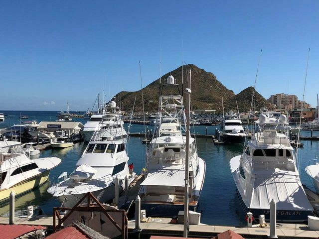 Highly desirable location with direct frontage onto the Cabo San Lucas Marina. This two bedroom two bath condo is a second floor unit at Tesoro Hotel, remodeled with high quality finishes and flooring.