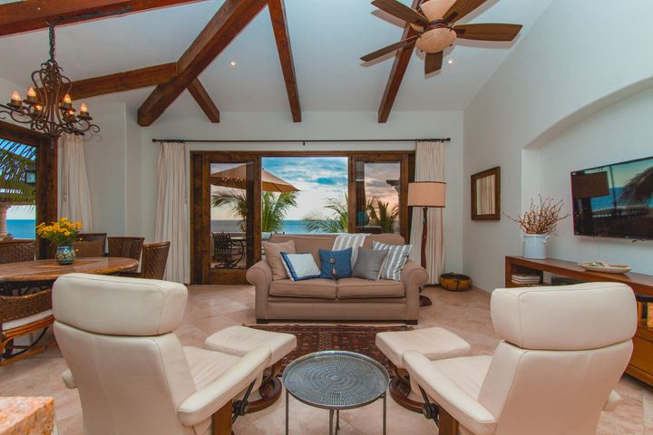 Located on the top level corner of the B building, the B301 unit enjoys panoramic views of the Sea of Cortez out to Palmilla Point.  This lavishly appointed 2 bedroom , 2 bathroom condo comes fully furnished and needs nothing. This is the first time on the market since originally built approximately 10 years ago. The attention to detail and care of the unit shows throughout. The community of El Encanto is the perfect mix of luxury, beachfront location, privacy, all in a boutique and well established community. The common areas of the phase I are some of the nicest you will find in Los Cabos.