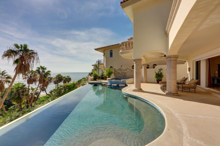 "Welcome to Villa Ballena Vista!Luxury ocean front property in Cabo is a rarity, particularly at this price point!Welcome to Villa Ballena Vista. This gorgeous ocean front 4-bedroom, 4.5-bathroom residence is in the private and exclusive double gated community of Playa Del Rey.  This Mediterranean style, two-storey home sits atop the cliff overlooking Cabo Bello beach.  From almost every living space, indoor or out, the home offers magnificent unobstructed views of the sea of Cortez where you can watch the whales frolic with their babies, enjoy sunsets or simply listen to the sounds of the ocean.As you enter the front door, you can't help but be taken in by the airy, open feeling and amazing ocean views. Notice the home's high ceilings and massive living and dining spaces, all designed to entertain your family and friends in style as they take in endless ocean views.  Delight in the well-equipped kitchen, adjoining butler's pantry and bar, all designed to make this home an entertainer's dream.   Outdoor living in this home is second to none. The home offer's a variety of patio spaces to relax on while watching the whales in the bay.  Soak in the pool or Jacuzzi and listen to the waves crash against the beach, watch the boats sail by or take in epic sunrises. The outdoor kitchen is perfect for entertaining friends and family.  Walk down to the semi-private swimmable beach â"" steps from your front door. The options to enjoy this home are endless. At the end of the day, retire to one of home's 4 Master suites. The main floor Master Suite provides direct access to a pool side seating area and offers a large en-suite with double vanity, jacuzzi and an enormous dressing room.   On the first floor, there are three additional Master suites, each equipped with an en-suite and designed to offer your guests a luxurious, private retreat with amazing views. One of the second-floor suites offer's it's guests a private and secluded ocean front terrace to enjoy sunrise or work on your tan in privacy.  This home must be seen to be truly appreciated."