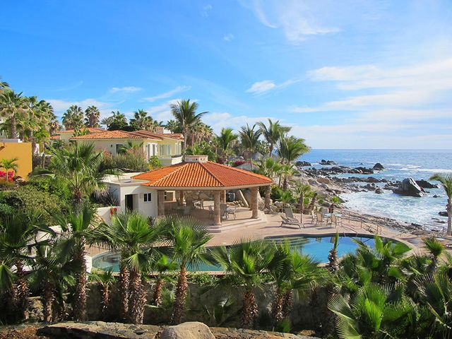 *(SELLER FINANCING for a qualified Buyer)  -  ''Casa L'' is a 3 BD, 3.5 BA & is celebrated within a VERY distinct ocean front development only @ 3 miles from downtown Cabo in Santa Carmela. This prized area offers 2 tennis courts, 2 pool areas & their very own oceanfront beach club for personal & group entertaining. Large pool, seating, hammocks, BBQ/kitchen area. (All recently renovated) The home offers an aggressive sales price while most homes within this address are listed for well more than $1 million usd. Private home, yard, pet friendly w/ space for a pool but don't forget about the 2nd pool within a 1 min walk from the front door. Viking stove, granite, throughout kitchen/bathrooms, roof top deck space w/ amazing ocean views & too much to list. Super low HOA, secure guarded entry.