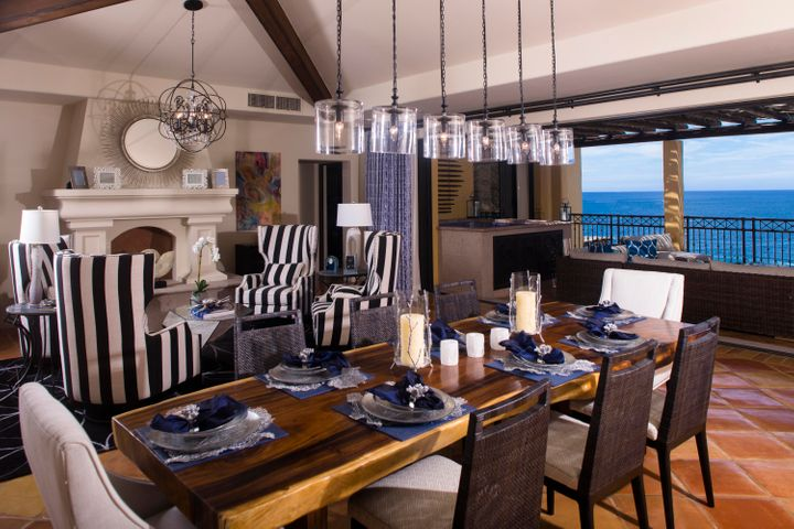Allow the ocean view from this beautiful penthouse stir your heart and warm your soul.  The bay of Cabo San Lucas is framed by luxurious bedrooms and living spaces all designed by the renowned Ladco Interiors.  Open floor spaces create an easy flow from the entrance, thru the kitchen, dining area, living area and outside living space.  Vaulted ceilings are featured in the dining and living area along with specially selected light fixtures and wall art.  The outdoor terrace includes a large seating area, built in grill and Jacuzzi/spa.  A secondary private terrace off the master bedroom is an ideal and comfortable place to watch the sun rise up out of the bay.  Three additional bedrooms and three and a half bathrooms complete the layout of this penthouse. Hacienda Beach Club & Residences define oceanfront living with direct access to the white sand, swimmable beach and all the beach activities imaginable.  Also included is the full-service Hacienda Spa, a fitness club, adult only pools and hot tubs and a supervised Kids Club.  A wide array of restaurants, shopping and nightlife are a moments walk away.