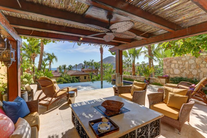 One of a kind in Hacienda.  The only residence with two main entries and a direct view to Lands End.  See incredible sunrises, enjoy the swimming beach, or take an easy stroll to the Marina, restaurants, nightlife and the shopping mall.  This Veranda has been expanded to include spectacular stone work and ceiling details adding more interior space.  The large open living room, kitchen and bar area include granite counter tops and lighting features creating unique atmospheres with views of the garden and walking path to the famed Medano Beach.  An open kitchen, private pool, grill area and fire pit are just some of the features of this extraordinary Veranda residence