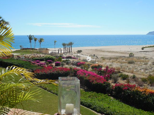 LOCATION LOCATION This charming fully furnished 2 BD 2 BA has a fabulous view of the beach, ocean and pools.  Just steps to all the amenities of Casa del Mar Hotel & Spa including 8 swimming pools, 2 Jacuzzis, 4 lite tennis courts, gym, full service spa, restaurants and championship golf in the Heart of the Golden Corridor......This property includes a garage & storage ($35K value)....Would make an excellent vacation/rental income property.  Totally Turnkey...Must See!