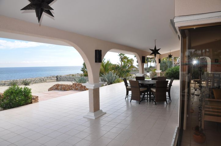 Beautiful, open Beachfront home.  3 bedroom, 2 bath, 2 car garage.  28 meters of beachfront located in a very quiet subdivision. 2 mile north of Central Los BarrilesLarge lot with room to expand or add pool. Well kept, ready to move in.  Don't miss out on this one.