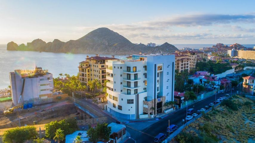 70 Meters to Medano Beach this two bedroom two bath condo is located at One Medano Beach.  This ground floor unit with your own patio opens up to the pool, hot tub and BBQ area. Underground parking.  Great Rental Income. Short walk to the Marina and Paraiso Mall.