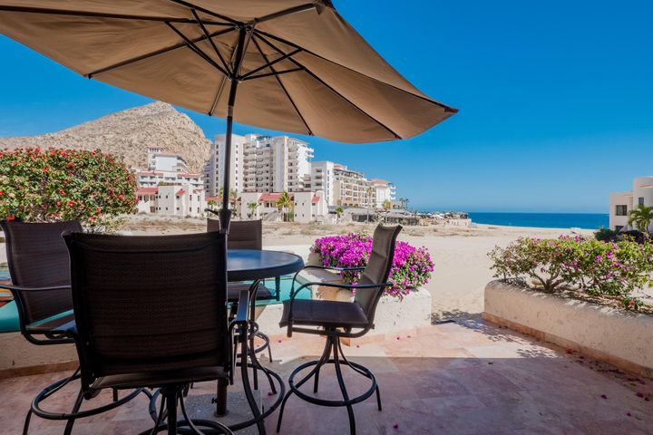 Affordable Single Level Ocean View Condo on the Beach in Cabo San Lucas! This turnkey spacious Studio in Terrasol is 1,140 Sqft. & has been remodeled with top of the line finishes such as granite counter tops, marble floors, fireplace & stainless steel appliances. Enjoy whale watching & spectacular sunsets right from your big, private terrace. Walk just a few steps to the beach & fall asleep with the Pacific Ocean surf. Terrasol is one of the landmark & most unique pieces of Real Estate in Cabo. The recently renovated common area offers palapa restaurant w/swim up bar, 2 pools, gym & tennis courts. Located walking distance to downtown, marina, swimmable beaches, outstanding snorkeling, restaurants, shopping & much more. Excellent investment property with high demand for vacation rentals.
