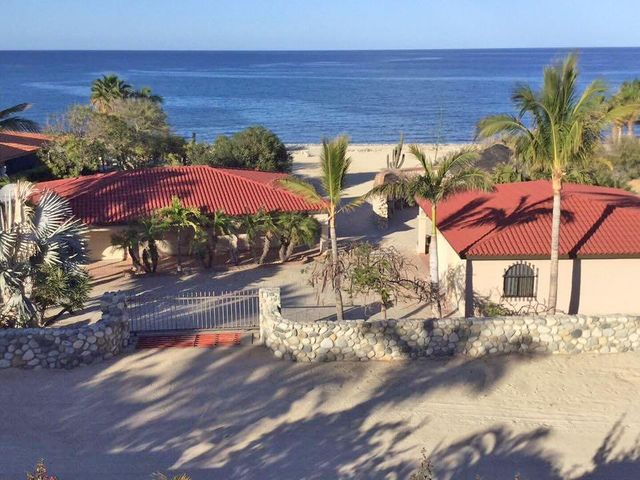 Beautiful beachfront property. 2 casitas with garages have been built on the property. Each casita has one bedroom,great room, kitchen and full bath. One casita has a 1 car garage attached, the other a 2 car garage attached. Lots of room to build the main home at the front of the property, closest to the beach. Mission area for BBQ, dancing and entertaining. Beautifully maintained landscaping.Priced to sell - motivated seller
