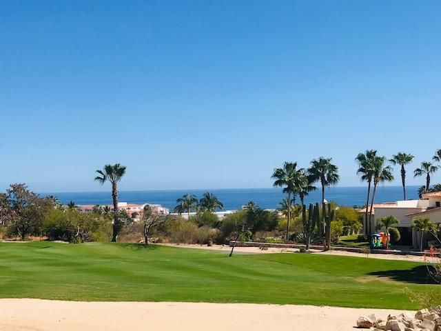 This rare two bedroom ground floor corner unit in Golondrina building within Cabo Real offers stunning and expansive unobstructuble ocean views overlooking the golf course of Cabo Real. The  gated private corridor to this corner unit, guarantees the future owners a complete tranquility and ensures that they will enjoy a living with no ''walking traffic'' at their front door. The condo has a large corner shaped patio surounded with land scaping and garden. The patio and all windows are protected with motorized hurrican shutters offering a safe living  during the storm seasons. There is an additional patio that offers privacy, perfect to be converted into outdoor living area where you can build your fire pit, add a set of chairs and enjoy a glass of wine under the starry sky.  The spacious kitchen offers solid surface counter tops with stainless steel appliances and beautiful wood cabinetry. The condo offers two large bedrooms, each one of them with its own bath, laundry room and spacefull living and dinning room. Definitelly one of the best units in the development and with no doubt a MUST SEE!