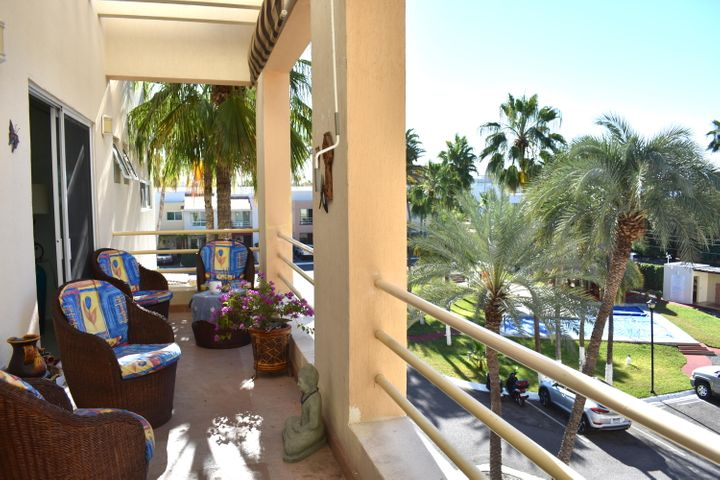 It's all about location! This spacious 3BR, 2.5BA 2-story penthouse condo is located in the private gated community of Ocean Oasis, just steps from the La Paz malecon, marinas, and all that downtown La Paz has to offer. This condo is one of only a handful of Penthouse units that has elevator access and features over 2,100 sf of living space and a view of the pool area and surrounding city and mountains. The unit offers soaring 2-story ceilings, plenty of light throughout, and a fully renovated kitchen with stainless appliances, granite countertops, hardwood cabinets and breakfast bar. One bedroom and bath on the main floor and 2 more bedrooms and baths upstairs offer plenty of flexibility for guests. An open loft overlooks the living area, perfect for an office or art studio. Private community includes 24 hour restricted access, plus a pool and BBQ area. Large laundry room provides plenty of options for storage.