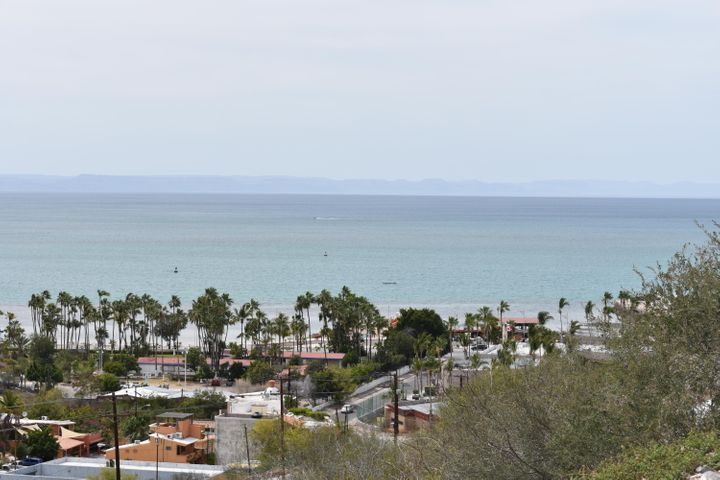 Build your dream ocean view home and walk to the malecon! This beautiful lot is perched on the outer edge of Lomas de Palmira, overlooking the La Paz bay, malecon, and daily stunning sunsets. The lot features paved road and all connections to electric, water and sewers are available. Soil and retaining wall reports are complete, ready to build now!
