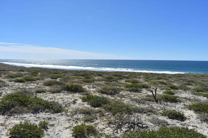 Pacific North huge ocean view lot for less than $50,000! This amazing lot features a panoramic Pacific Ocean view and is just steps away from a swimmable beach that also offers excellent surfing as well as great fishing and diving right off shore, and wind surfing during windy season. This easily buildable lot is situated just north of La Paz between Punta Marquez and Punta Conejo, and features a gently sloping home site with amazing 180 degree views of the surf break and surrounding mesas. Parcel 151 is 53,877 m2 (just under 13.5 acres) and spans from the access road to halfway up the mesa. Solar energy systems and internet services up to 20MB/s download speeds are available at these sites. Use one of our recommended builders or bring your own, and start enjoying the amazing Pacific sunsets.  Also see Vistas del Mar Lot 337 (MLS #19-278) and Lot 338 (MLS #19-276) for beachfront lots priced below $50,000 as well as Lot 102 (MLS #19-671) for a huge 4.5 acre beachfront lot with 70 meters of oceanfront for $119,900.