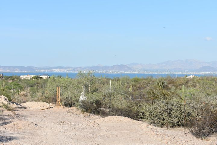 Build your dream home on the best ocean view lot in the best El Centenario neighborhood! This 1,497m2 lot in Phase 2 of Haciendas Palo Verde offers a gently slope to make it easy to build your home, and offers gorgeous views of the La Paz bay, city lights and mountains beyond. The lot is situated on the ocean-facing side of the main road, which means better ocean views and more privacy. The neighborhood is the only gated community in the area and offers 24/7 guarded main gate, paved internal roads, all underground infrastructure, weekly garbage service, and casa club with lap pool and small gym. We have several builders to choose from, come see it for yourself and start living the Baja dream.