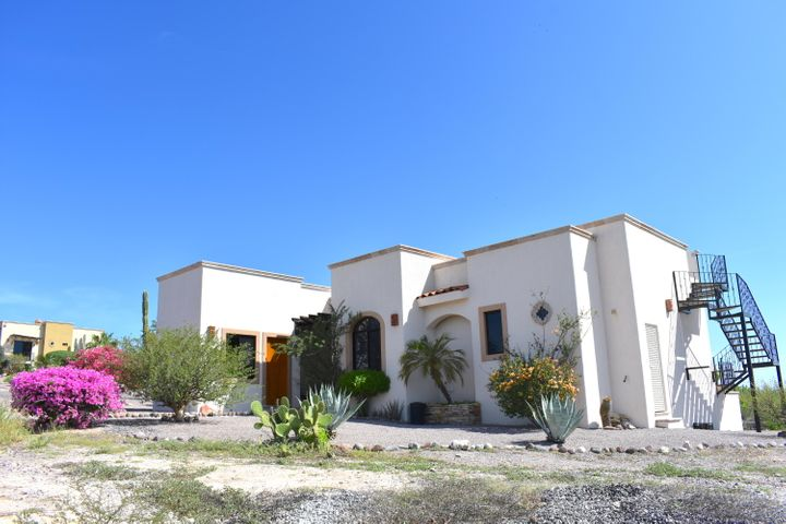 Back on the market: the lowest priced home in the best El Centenario neighborhood! This 3BR/2BA home located in the private gated community of Haciendas Palo Verde features an open-concept floorplan, stainless appliances, granite countertops, tile floors, hardwood finishes, and ocean views from both the outdoor terrace and rooftop patio. Situated on nearly 0.4 acres with plenty of room for a pool. The separate 3rd bedroom is ideal as an art studio or office. Community amenities include paved roads, a clubhouse with gym and lap pool, underground utilities and gated, 24-hour security. Just minutes to shopping at Walmart, Home Depot, Sam's Club and an easy drive to downtown La Paz.