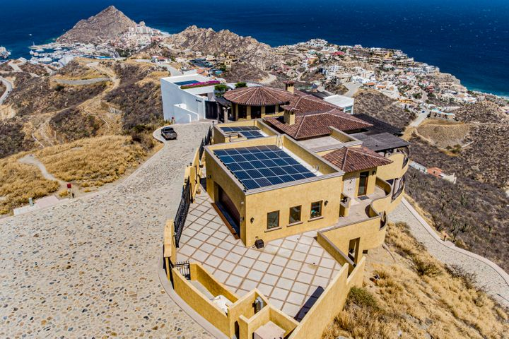 Villa Alta Vista, is Pedregals ''King of The Hill''. Where else can you have all the best views Cabo has to offer? The Pacific, Sea of Cortez, city lights and mountain views, 360 degrees of pure bliss!! Built in 2017, this engineering marvel has a total construction of 10,995 sq/ft, of which 7,697 sq/ft is interior space. The property has 5 bedrooms with vast patios, and 6 1/2 bathrooms. Home features includes: 38 solar panels, a putting green, infinity pool, hot tub, huge gas fire pit, 2 grand fire places, double garage, additional secured parking for 3, 50lb/day ice maker, wine fridge, spacious office, multiple patios, outdoor showers, hurricane protection, a 360-degree view tower, double pane windows & screens and a gourmet kitchen with GE Monogram appliances. The list goes on and on, just like that last sentence! Comes fully furnished, minus any personal items and an inventory/exclusion list will be provided with submitted offers. Watch the whales of the  wild Pacific, October through late April from your any of the terraces while enjoying a beverage. The development of Pedregal is a synonymous with Cabo and has amazing vacation rental history. Every investment rental in Pedregal has the ability to do extremely well! Within the community there is 24-hour roaming security and you have access to the gym, spa, juice bar, tennis/pickle ball courts and beach. Just outside the security gate, is downtown, Medano beach access AND the famous Cabo marina which is HOME to Richest Marlin Fishing Tournament In The World with over $4.5 million paid out in 2019!!!!!  How is this not, the ultimate opportunity! You must see it for yourself, because no other home can offer these views! Sellers are motivated! Call us today for more information!
