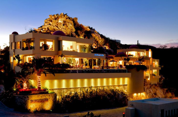 Perched high above the city lights of storied Cabo San Lucas, a remarkable structure is chiseled into the Pedregal mountain. Modern, and, yet, timeless in design, La Diosa de la Luna, is an unique seven bedroom luxury estate that commands a panoramic view of two Seas and rugged cliffs, the Cabo Marina, the city and the beach all the way to Misiones Del Cabo point, overlooking the iconic formation of El Arco of Cabo the place where the deep blue waters of the Pacific Ocean meet the limpid lagoons of the Sea of Cortez. Inside, and out, calming water flows gently underfoot  throughout the Villa.  The Zen of nature seems the foundation of this brilliantly designed and spectacular lifestyle environment.  Peace and tranquility are as fundamental as nature inside, as the surrealistically brutal and pitiless beauty of the end-of-the-land topography is outside where the choya and mesquite exhibit the unconquerability of nature's toughest beauties, their knarled raices, reaching indomitable into every crevice to assure their rightful and amazing tenacity prevail each spring with the transformational desert bloom and confirm that life belongs to those who insist on it and strive regardless of the challenges ...  This house unmistakably confirms its residents manifest that same such spirit of conquest and demand of life against all odds of success.  Inscrutable subtlety of varying hues of granite slabs, unearthly in soft polished and yet tractable, stone colors ebb and flow, above and below the ever-present canals and gentle cascades, schools of oriental Koi affirm the natural honesty of this Venice-in-the-Baja; a human-made wonder of structural and aesthetic engineering that observes and respects the God and nature-made phenomenon of the brutal terrain of the desert fox and majestic aerial kingdom of eagles, condors, and falcons.    The finest of ancient Mexican craftsmanship is exquisitely fused to the modernity of this floating world hovering beneath the Diosa de la Luna.  S