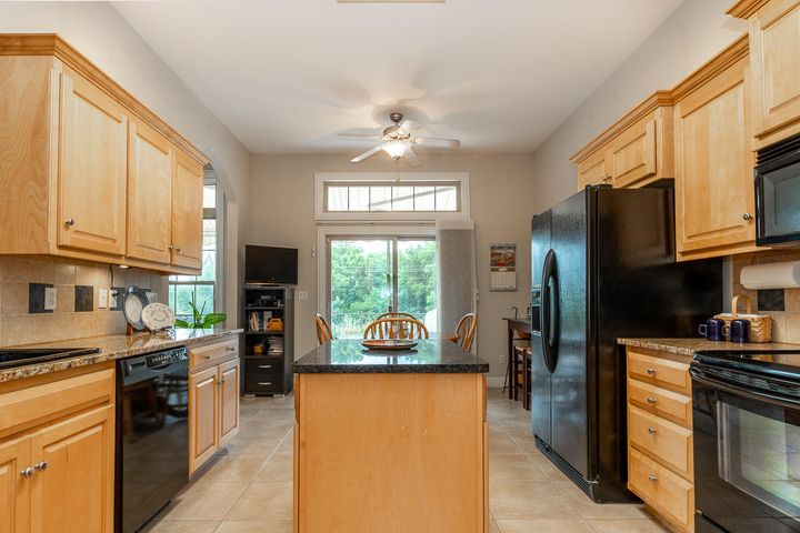 Under cabinet lighting, granite countertops, moveable island and southern exposure lighting!